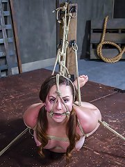 Bosomy milf with nipples clamped and tied to toe..