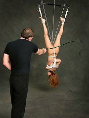 Submissive redhead gets suspended and punished